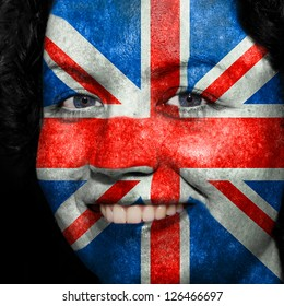 Woman with flag painted on her face to show UK support in sports