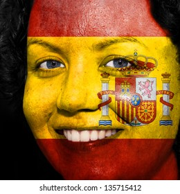 Woman with flag painted on her face to show Spain support in sports