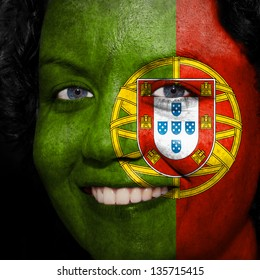 Woman with flag painted on her face to show Portugal support in sports