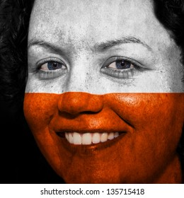 Woman with flag painted on her face to show Poland support in sports
