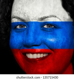 Woman with flag painted on her face to show Russia support in sports