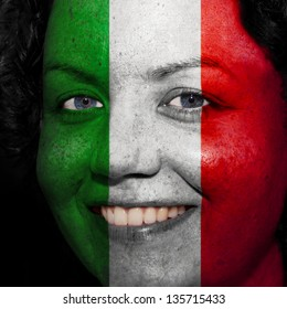Woman with flag painted on her face to show Italy support in sports