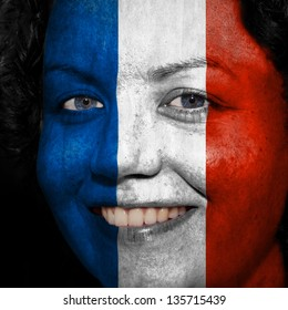 Woman with flag painted on her face to show France support in sports