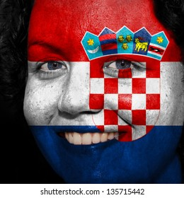 Woman with flag painted on her face to show Croatia support in sports