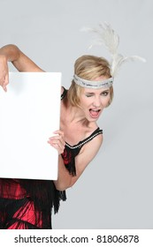 Woman in a flapper's outfit with a board left blank for your message