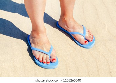 Woman in flip flops on beach