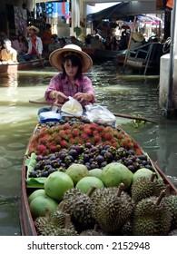 a woman at the floating market in bangkok, thailand