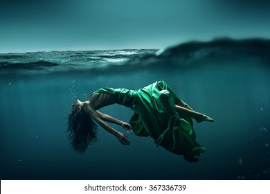 Woman floats underwater