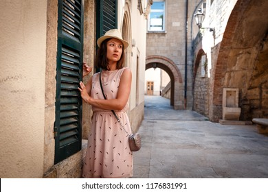 Woman in Florence. Brunette girl standing by the old historic building. Florence cityscape. Italy. Famous destination in Italy.