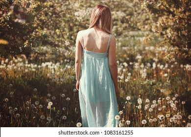 Woman in a flower field. Outdoor portrait