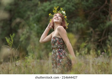 A woman with a flowered wreath around the head