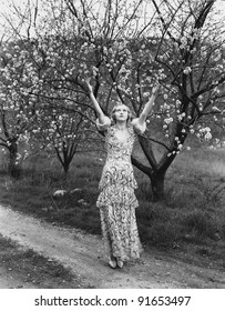 Woman with flowering trees