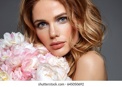 Woman with flowers. Beauty. Make up. Fashion style.