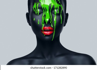 woman with flowing green paint