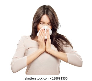 Woman with flu, holding tissue