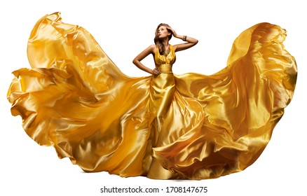 Woman in Fluttering Gold Dress on White, Waving Silk Cloth, Artistic Fashion Model in Golden Color Fabric