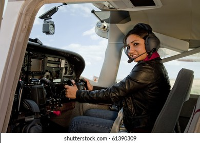 A woman flying an airplane