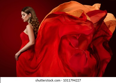 Woman Flying Dress, Elegant Fashion Model in Fluttering Red Gown, Beautiful Girl and Waving Silk Fabric