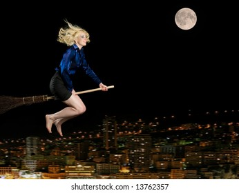 Woman is flying on broom over Night City. The City on Motion Blur