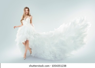 Woman Flying White Dress, Elegant Fashion Model Fluttering Gown Train, Young Girl Studio Beauty Portrait