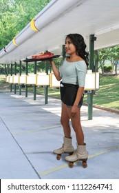 Woman food service worker server or waitress on roller skates