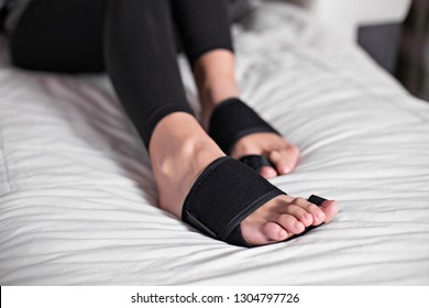 Woman foot bunion protection. Bunion corrector. lifestyles photos in bed, on floor. different angels.