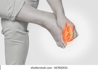 Woman foot nail pain.Concept photo with Color Enhanced pale skin with Fire indicating location of the pain.