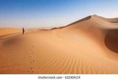Woman Foot prints in the arabian desert