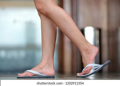 woman foot in Sandals walk on the floor