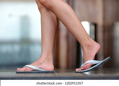 woman foot in Sandals walk on the floor