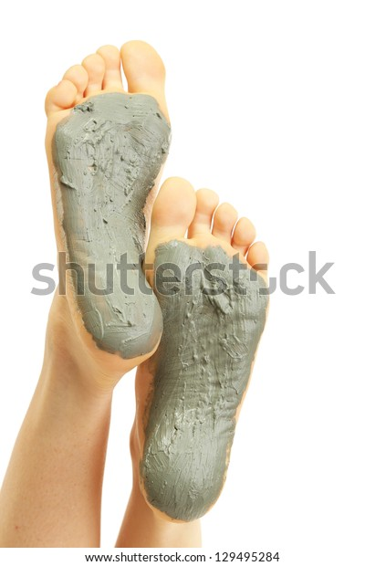Woman foots with cosmetics, isolated on white