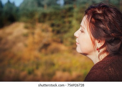 Woman in a forest in an autumn day