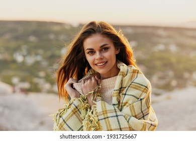 woman with fred on nature in the mountains smiling model