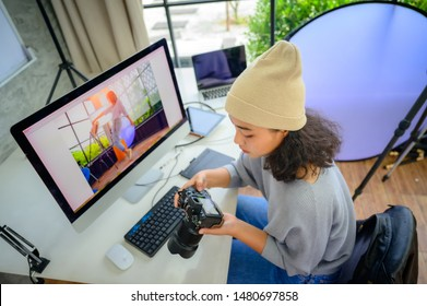 woman freelance photographer and blogger working individual at own office studio