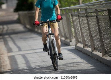 Woman freerider riding mountain bike on city, Sports extreme and active lifestyle.