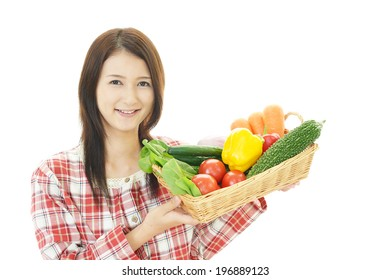 Woman with fresh fruits