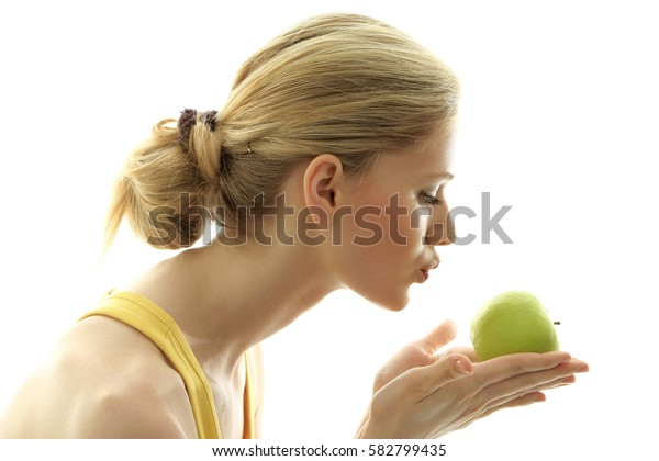 Woman with a fresh green apple