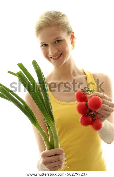 Woman with fresh vegetables tomatos and spring onions