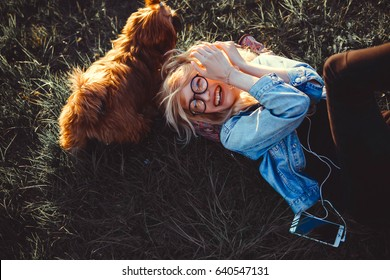 woman, friend, portrait of young beautiful woman in sunglasses sitting on park hugging golden retriever dog. girl with dog by sea. happiness and friendship,girl playing with dog on sea shore