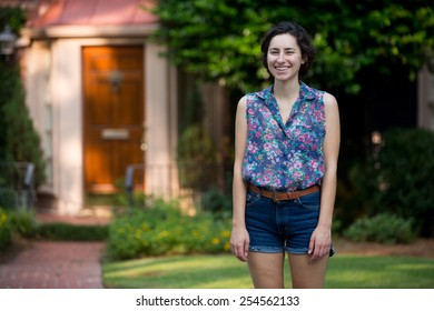 woman in front of first home