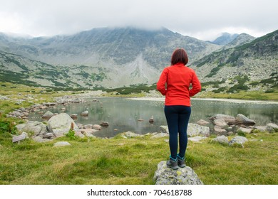Woman in front of a mountain lake