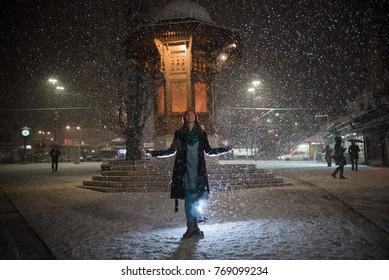 woman in front of Sebilj in Sarajevo