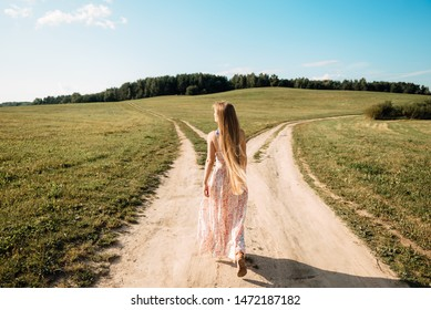 woman in front of two roads thinking deciding hoping for best taking chance
