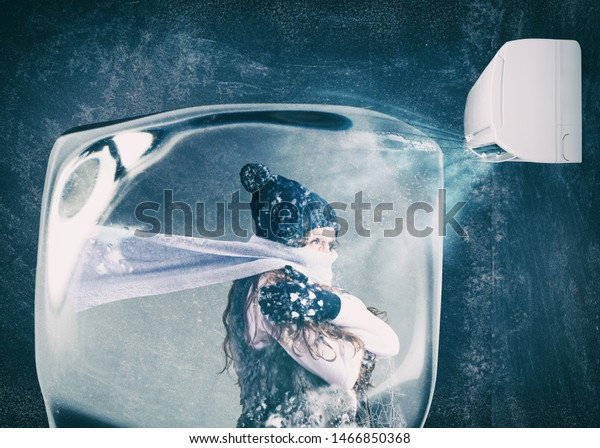 Woman frozen in an ice cube under the air jet of an air conditioner