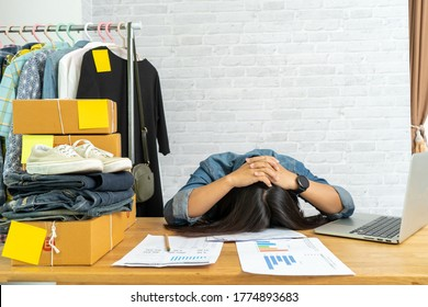Woman frustrated exhausted laid her head down on the table, Selling online start up small business owner, e-commerce ideas concept