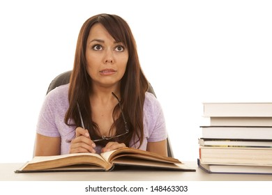 a woman with a funny expression on her face looking up, and being surrounded by a bunch of books.