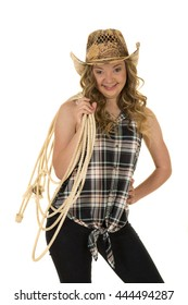 A woman with a funny expression on her face, she has down syndrome holding a rope.