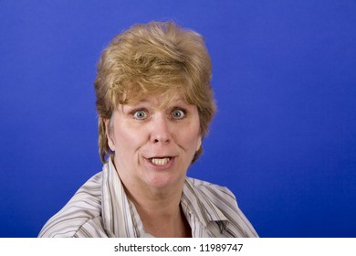 woman with a funny look on her face on a blue background