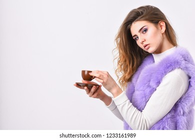 Woman fur coat drink coffee. Elite coffee concept. Elite coffee variety concept. Elite drink with caffeine. Lady drink espresso little ceramic cup white background. Enjoy aroma and taste hot coffee.