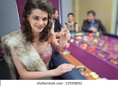 Woman in fur stole a roulette table in casino